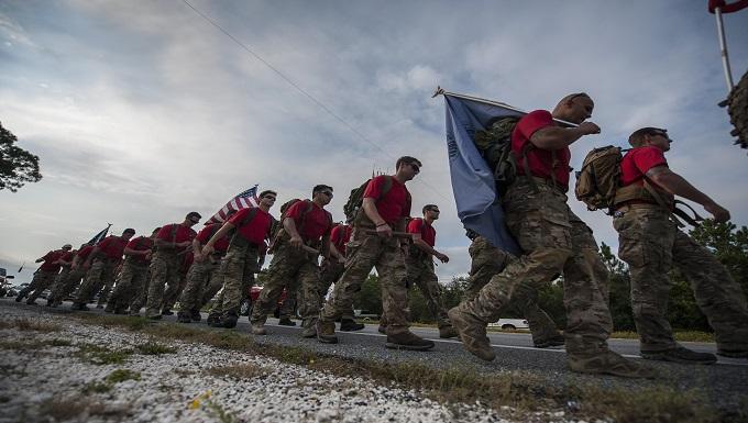 Special Tactics Airmen carry 20 batons during a memorial march to Hurlburt Field, Fla., Oct. 13, 2015.
